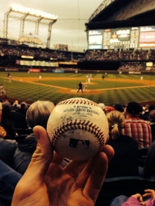 Holding a baseball at a game