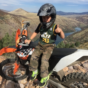 Son on a dirtbike