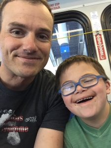 Brady and son on the bus